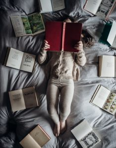 Girl surrounded by books