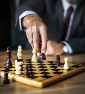 Man makes a chess move